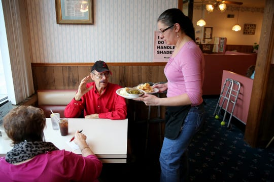 Mary Stone, daughter of Chris and Stephanie Stone, serves lunch to customers, Friday, Jan. 24, 2020, at Stone Family Restaurant in Cheviot. The neighborhood restaurant closed on Saturday after first opening in 1962.