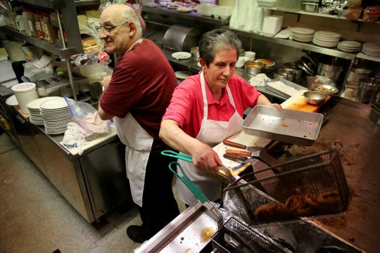 Chris and Stephanie Stone work in the 11x14 kitchen, Friday, Jan. 24, 2020, at Stone Family Restaurant in Cheviot. The couple is retiring and the neighborhood restaurant will close on Saturday after first opening in 1962.