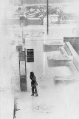 JANUARY 26, 1978: Lonely vigil is kept by this Eskimo-like figure waiting for a bus downtown afternoon.