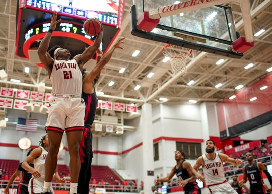 Austin Peay's Terry Taylor (21) jumps to catch a rebound in an Ohio Valley Conference basketball game between the Austin Peay Governors and Tennessee State Tigers at Austin Peay Dunn Center in Clarksville, Tenn., on Thursday, Jan. 23, 2020.