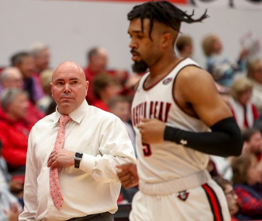 Austin Peay's head coach Matt Figger looks over to Jordyn Adams (5) in an Ohio Valley Conference basketball game between the Austin Peay Governors and Tennessee State Tigers at Austin Peay Dunn Center in Clarksville, Tenn., on Thursday, Jan. 23, 2020.
