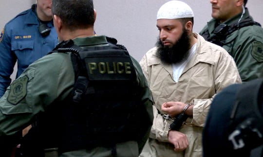 Seaside Park and Chelsea bomber Ahmad Khan Rahimi is escorted in to State Superior Court in Elizabeth, NJ, for sentencing on the shootout with Linden police officers that resulted in his arrest.
