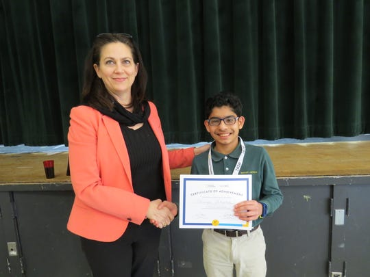 Dr. Corinna Crafton, Middle School Head at The Wardlaw+Hartridge School in Edison, announced the winner of the National Geography Bee contest. Shourya Chhabra of Roselle Park took first place.