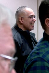 Former Linden Police Officer Angel Padilla smiles after Seaside Park and Chelsea bomber Ahmad Khan Rahami was sentenced in State Superior Court in Elizabeth, N.J. for the shootout with Linden police officers what resulted in his arrest and the wounding of Padilla.