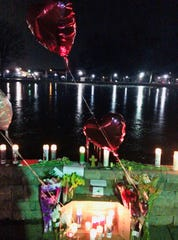 The memorial for David Tillberg at Carteret Park has grown to include flowers, candles and balloons.