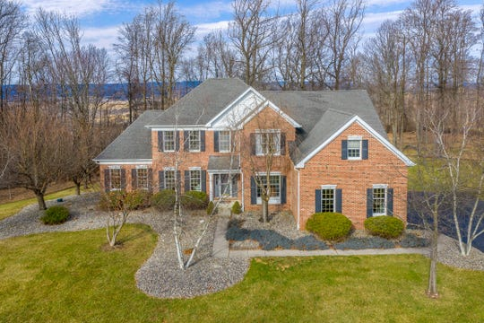 Located in theCharlestown Hills neighborhood, a Toll Brothers-built brick front Colonial surrounded by over three acres of open, level and woodland privacy is for sale for $529,900.