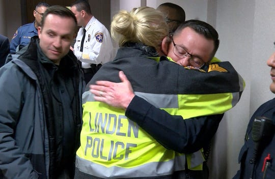 Linden Police Officer Pete Hammer shares a hug with another officer after Seaside Park and Chelsea bomber Ahmad Khan Rahimi was sentenced in State Superior Court in Elizabeth, NJ, for the shootout with Linden police officers that resulted in his arrest and the wounding of Padilla.