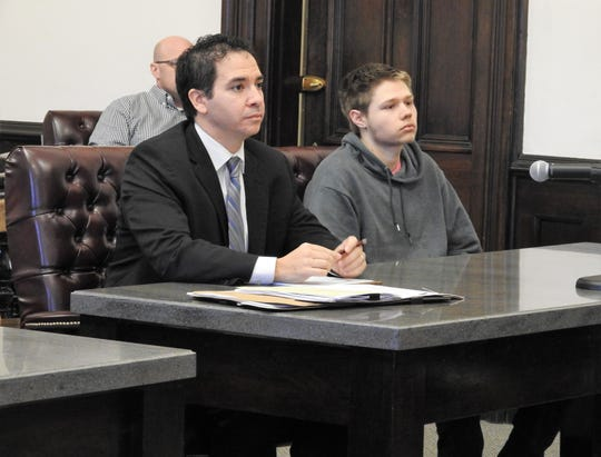 Attorney Edward Itayim with client Andre Deeds in Coshocton County Common Pleas Court. Deeds received three years of community control sanctions and was ordered to complete a community based corrections facility program in relation to a charge of intimidating a witness in a criminal case.