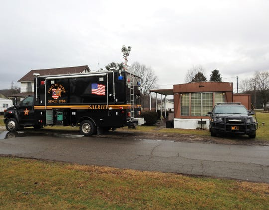 Authorities were present at a house trailer at 207 Biggs Ave. in Conesville on Friday in relation to what has become a murder investigation. Several items, including a motor vehicle, were taken from the home in relation to the case.