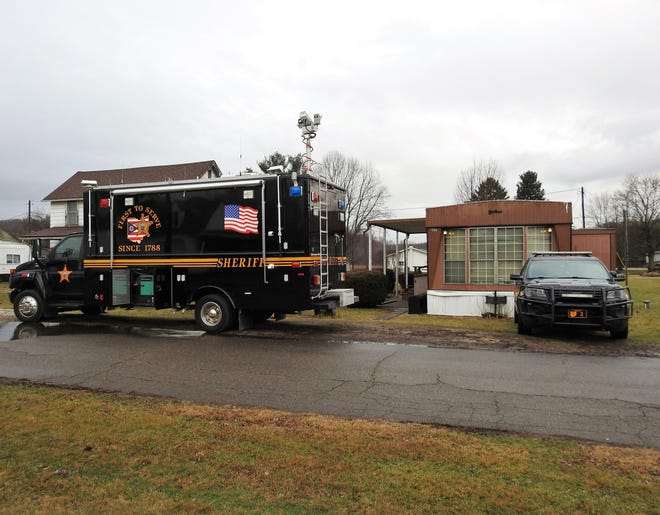 The Mobile Command Center of the Coshocton County Sheriff's Office and a cruiser were positioned Friday morning in front of a house trailer at 207 Biggs Ave., Conesville. Capt. Dean Hettinger said the presence was in relation to a missing adult male.