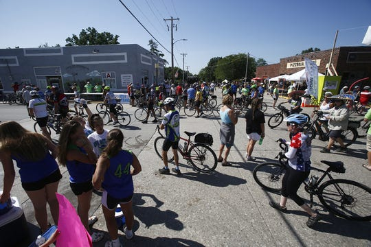 Riders pedal and walk their way into Norwalk. RAGBRAI brought riders from Winterset through Cumming and Norwalk to Indianola on Tuesday, July 23, 2019.