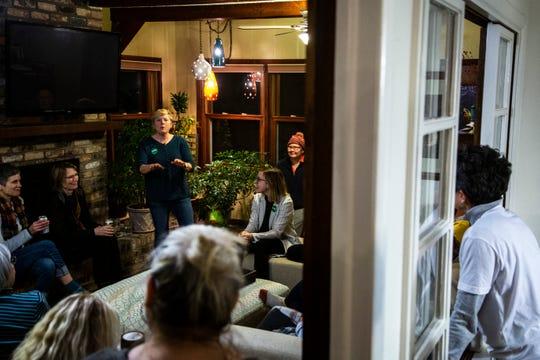 "Melissa Fath introduces Abigail Klobuchar Bessler, daughter of Democratic presidential candidate U.S. Sen. Amy Klobuchar during a ""Hotdish House Party,"" Wednesday, Jan. 22, 2020, in Iowa City, Iowa."
