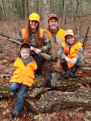 Heather Iverson with her husband and two children on a squirrel hunt.