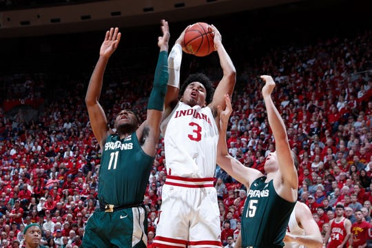 Indiana's Justin Smith rebounds against Michigan State's Aaron Henry (11) during the first half Thursday.