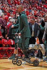 Michigan State guard Joshua Langford, who is injured, uses a scooter to go across the floor before the second half of MSU's 67-63 loss to Indiana on Thursday, Jan. 23, 2020, in Bloomington, Indiana.