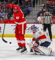 Detroit Red Wings' Givani Smith tries to redirect a shot against Florida Panthers goaltender Sergei Bobrovsky at Little Caesars Arena, Jan. 18, 2020.
