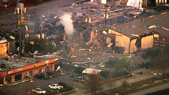 This aerial photo taken from video provided by KTRK-TV shows damage to buildings after an explosion in Houston on Friday, Jan. 24, 2020.  A large explosion left rubble scattered in the area, damaged nearby homes and was felt for miles away. A fire continues to burn and people have been told to avoid the area.