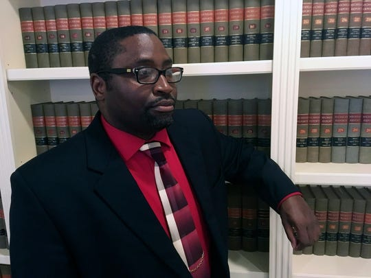Sauntore Thomas poses in his attorneys office Thursday, Jan. 23, 2020 in Bloomfield Hills, Mich. Thomas, a black Air Force veteran who tried to deposit settlement checks from a discrimination lawsuit was rejected by his suburban Detroit bank, which suspected fraud and called police.