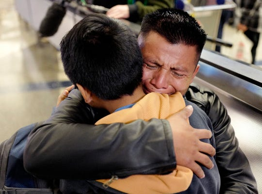 David Xol-Cholom, of Guatemala hugs his son Byron at Los Angeles International Airport as they reunite after being separated about one and half years ago during the Trump administration's wide-scale separation of immigrant families, Wednesday, Jan. 22, 2020, in Los Angeles.