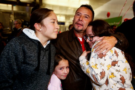 Esvin Fernando Arredondo of Guatemala reunites with his daughters Andrea, left, Keyli, right, and Alison, second from left, at Los Angeles International Airport after being separated during the Trump administration's wide-scale separation of immigrant families, Wednesday, Jan. 22, 2020, in Los Angeles.
