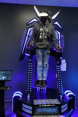 Darius Barber, 30, of Detroit plays an Ultra Infinity game where the platform moves with the game's action the at VR+ Zone in Ferndale, Mich. on Jan. 15, 2020.