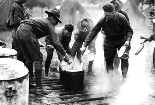 Mess time at U.S. Army Camp Custer during World War I. Camp Custer was one of the places that saw a major outbreak of Spanish flu.