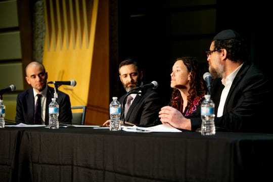 David Kurzmann, left, leads a panel including Rabbi Azaryah Cohen of Frankel Jewish Academy, Rabbi Jen Lader of Temple Israel and Rabbi Israel Pinson of Chabad in the D during a forum on anti-Semitism on Thursday.