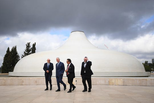 Britain's Prince Charles, second left, and Chief Rabbi Ephraim Mirvis, right, visit the Shrine of the Book at the Israel Museum in Jerusalem, Thursday Jan. 23, 2020.