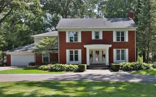 This stately brick colonial in Monroe is listed for $599,500.