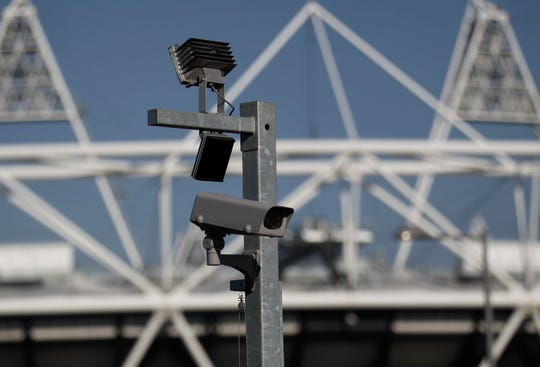 A security cctv camera by the Olympic Stadium at the Olympic Park in London.