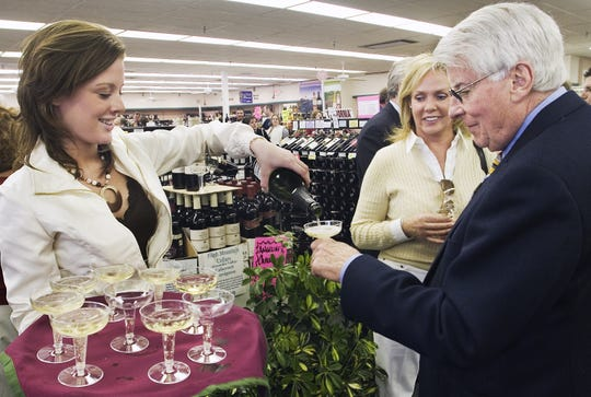Danielle Webster pours Pleasant Valley Millennium Brut sparkling wine for Richard Rahill of Hammondsport and Kim Krog of Orchard Park during GCP Discount Liquors & Wines expansion celebration in Horseheads in 2008.