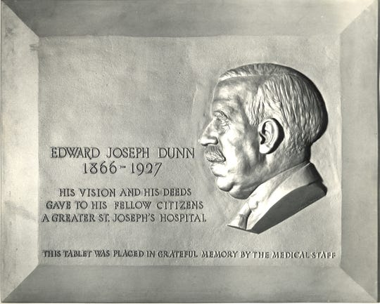 A plaque was dedicated to Edward Joseph Dunn, who was an integral figure in Elmira's history.