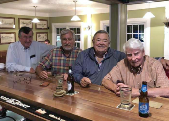 Richard E. Rahill, right, sits with friends, from right, Freeman Smith, retired Vice President of Government Relations at Corning, Inc., Jim Sherron, retired Steuben County Industrial Development Agency president and Michael Doyle, owner of Pleasant Valley Wine.