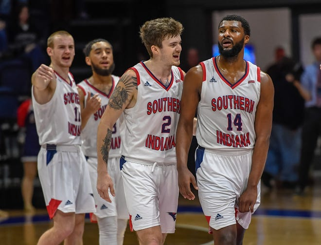 University of Southern Indiana's Clayton Hughes (2) gives some encouragement to teammate Emmanuel Little (14) in the final second of the game as the University of Southern Indiana Screaming Eagles play the Truman University Bulldogs at the Screaming Eagle arena Thursday, January 23, 2020.
