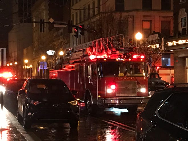 Evansville firefighters respond to the scene of a small fire downtown Thursday evening. The fire was in the building that houses Signature School and Victory Theatre.