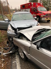 The aftermath of a head-on collision on the West side of Evansville Thursday afternoon. Three people were hospitalized and Hogue Road was closed for about two and a half hours.
