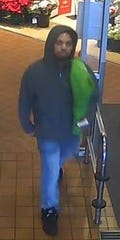 Evansville Police said this is one of three people suspected of passing counterfeit bills at the West Side Schnucks location.