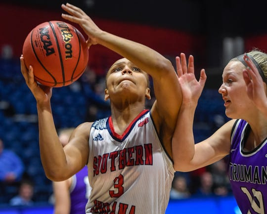 University of Southern Indiana's Kiara Moses (3) drives to the basket against defense from Hannah Pinkston (10) as the University of Southern Indiana Screaming Eagles play the Truman University Bulldogs at the Screaming Eagle arena Thursday, January 23, 2020.