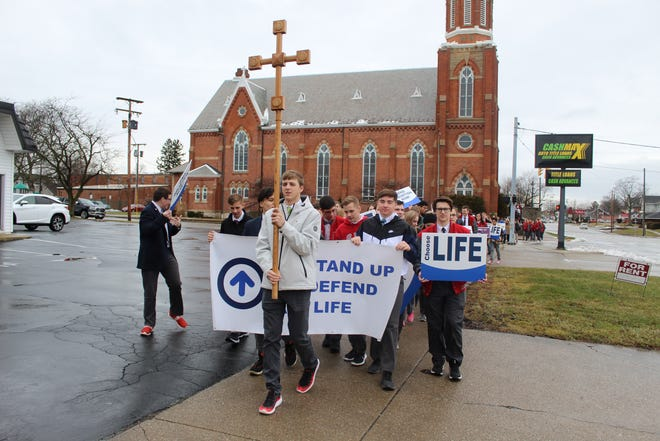 More than 50 students and community members marched for life Friday in Fremont. Parishioners marched from Saint Ann's Catholic Church, 1021 W. State St. to the Sandusky County Courthouse, 100 N. Park Ave. The local march was held a day before the national March for Life in Washington, D.C. on Saturday, marking 47 years since the Jan. 22, 1973 U.S. Supreme Court's Roe v. Wade ruling on abortion.