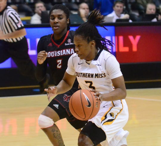 Southern Miss sophomore Keri Jewett-Giles runs down the court against University of Louisiana Lafayette Saturday in Reed Green Coliseum.