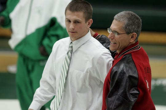 Longtime North Fort Myers High School wrestling coach Frank Drake (right) is among eight contributors and former student-athletes who will be inducted into the Lee County Athletic Conference Hall of Fame on April 23 in Fort Myers.
