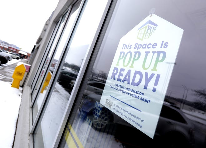 A sign saying 'This space is pop up ready' hangs in the window of a vacant business at 521 S. Military Ave. on Jan. 23, 2020, in Green Bay, Wis.