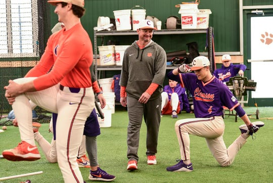 Clemson head coach Monte Lee walks around players during the first official team Spring practice at Doug Kingsmore Stadium in Clemson Friday, January 24, 2020.