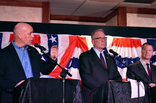 U.S. Rep. Greg Gianforte, left, speaks during a Republican gubernatorial primary debate Thursday as Attorney General Tim Fox, center, and state Sen. Al Olszewski listen at the Billings Hotel and Convention Center in Billings.