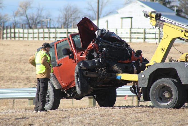 The front end of the Jeep Wrangler involved in Friday morning's fatal crash is completely destroyed. The driver; a Choteau woman in her 50s, survived the collision.
