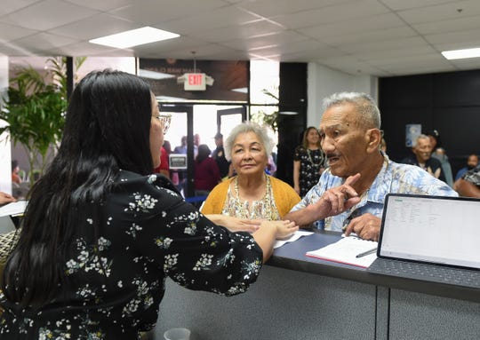 War survivors and their families line up to sign in at the Guam War Claims Processing Center in Tamuning on Jan. 24, 2020.