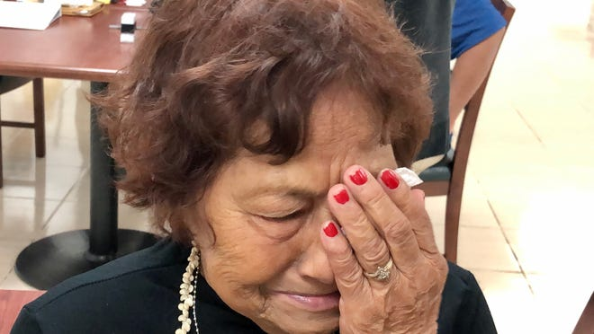 World War II survivor Florence Ninete Quitugua, 79, is overcome with emotions as she shares her and her family's experiences during the war and the long journey to get war reparations in this file photo.