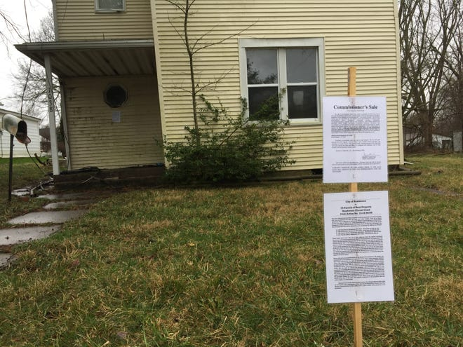 This house and lot at 1038 First Street was among the properties up for sale as part of a mass foreclosure action by the city of Henderson in 2020.