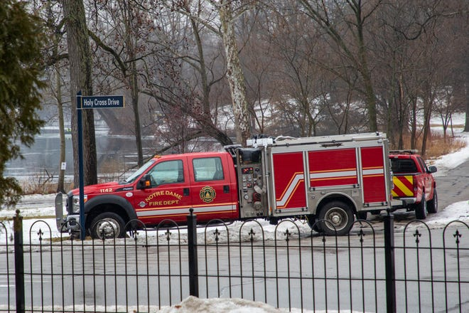 Emergency crews search Saint Mary's Lake at the University of Notre Dame on Friday, Jan. 24, 2020, in South Bend.