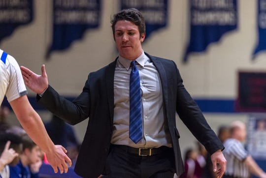 Bishop Chatard High School head coach Taylor Wayer reacts with players on the bench during the first half of a quarter-final game against Tindley High School in the Indianapolis City Boys' Basketball Tournament, Thursday, Jan. 23, 2020, at Bishop Chatard High School.